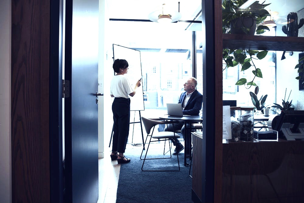 Business meeting between woman and man discussing business proofreading